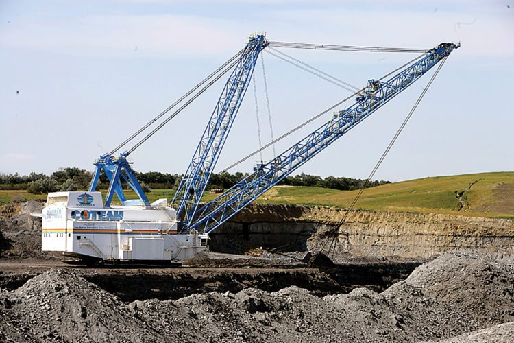 File Photo A dragline removed overburden at a coal mine in western North Dakota. The largest lignite mine in the United States – the Freedom Mine north of Beulah – sold the most coal during 2017.