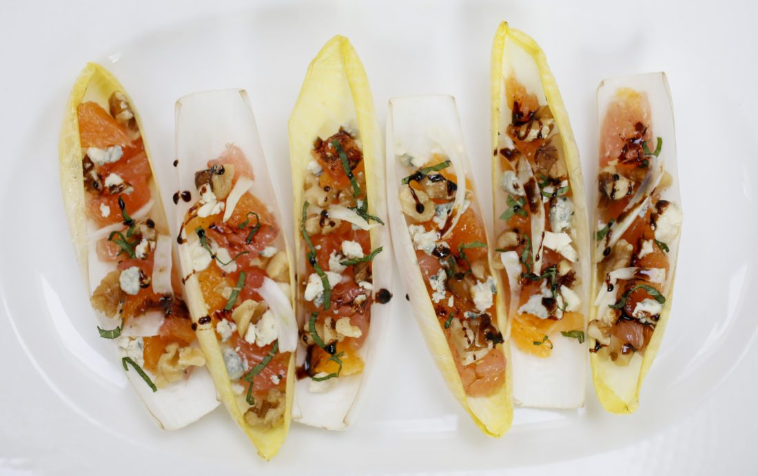 Belgian endive boats are made with citrus, fennel, blue cheese and walnuts.   Michael Vosburg / Forum Photo Editor