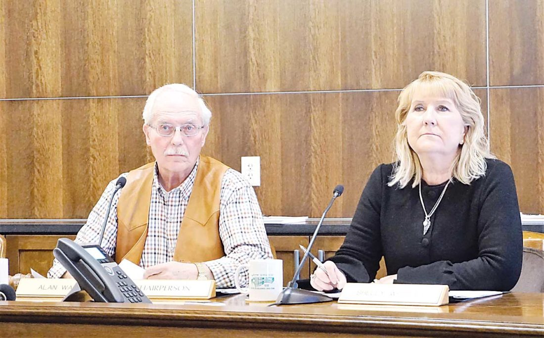 Jill Schramm/MDN County Commissioners Alan Walter and Shelly Weppler listen to testimony at a personnel committee meeting Tuesday.
