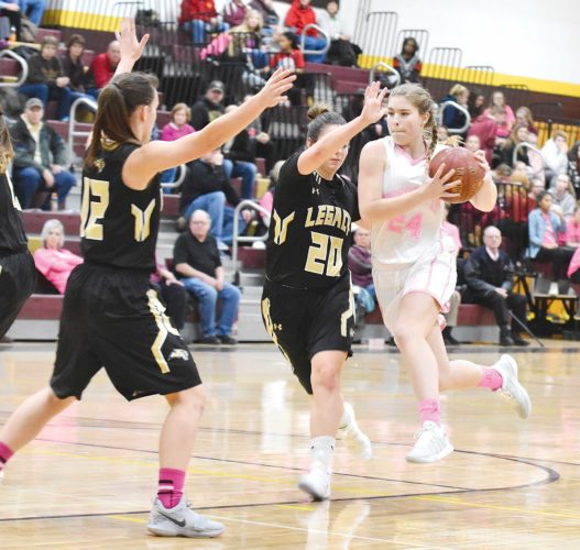 Garrick Hodge/MDN  Minot High's Gwen Mathews (24) drives to the basket during a girls high school basketball game Tuesday in Minot.