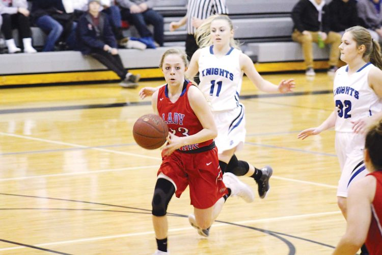 Ashton Gerard/MDN Des Lacs-Burlington's Sara Bonn (center) looks for the pass Tuesday in a game at Our Redeemer's.