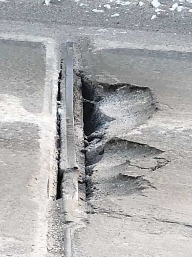 Submitted Photo A decaying portion of the southbound Broadway Bridge was patched by the City of Minot earlier this week. An inspector declared the bridge safe for vehicle travel.