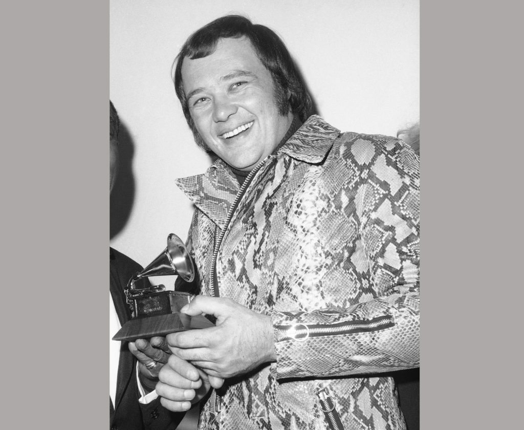 FILE - In this March 11, 1970 file photo, David Clayton-Thomas, lead singer of the rock group Blood, Sweat and Tears holds the Grammy Award for Album of the Year for their self-titled album at the Grammy Awards ceremony in New York. The group beat out fellow nominees, The Beatles, The 5th Dimension, Crosby, Stills & Nash and Johnny Cash. (AP Photo/Dave Pickoff, File)