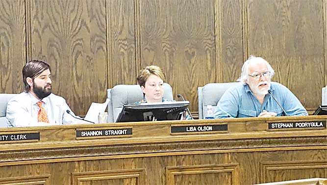 Jill Schramm/MDN Council member Stephan Podrygula, right, speaks at Wednesday's meeting as council members Shannon Straight and Lisa Olson listen at left.