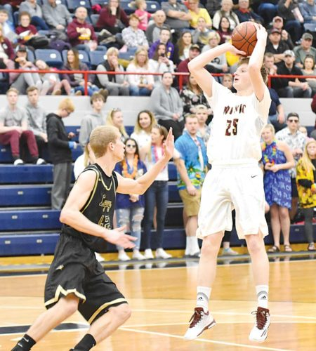 Garrick Hodge/MDN Minot High's Alex Schimke (25) pulls up for a jump shot during a boys high school basketball game Thursday at the Minot Municipal Auditorium.