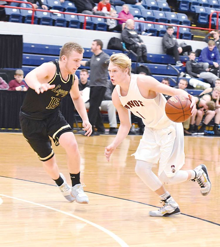 Garrick Hodge/MDN Minot High's Chandler Albertson (1) drives to the basket Thursday.