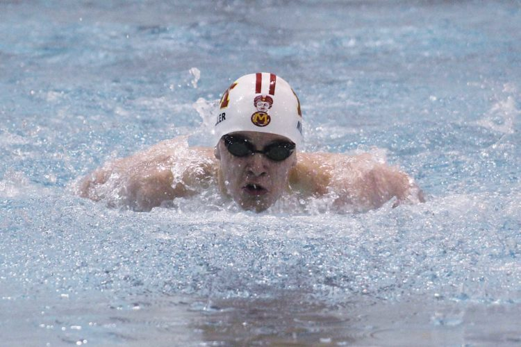 Ashton Gerard/MDN Minot High senior Gannon Miller takes a breath during his 100-yard butterfly, Friday at Magic City Campus. Miller finished second with a time of 1:00.21.