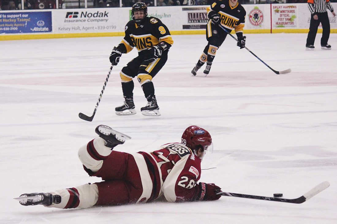Alex Eisen/MDN Minotauros forward Sam Fuss (28) slides on the ice after getting tripped in a NAHL game Friday evening against the Austin Bruins.