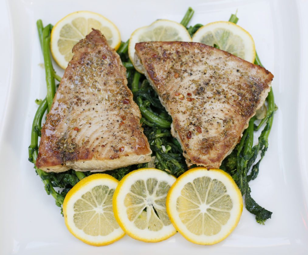 Sicilian-style swordfish is presented on a bed of rapini.   Michael Vosburg / Forum Photo Editor