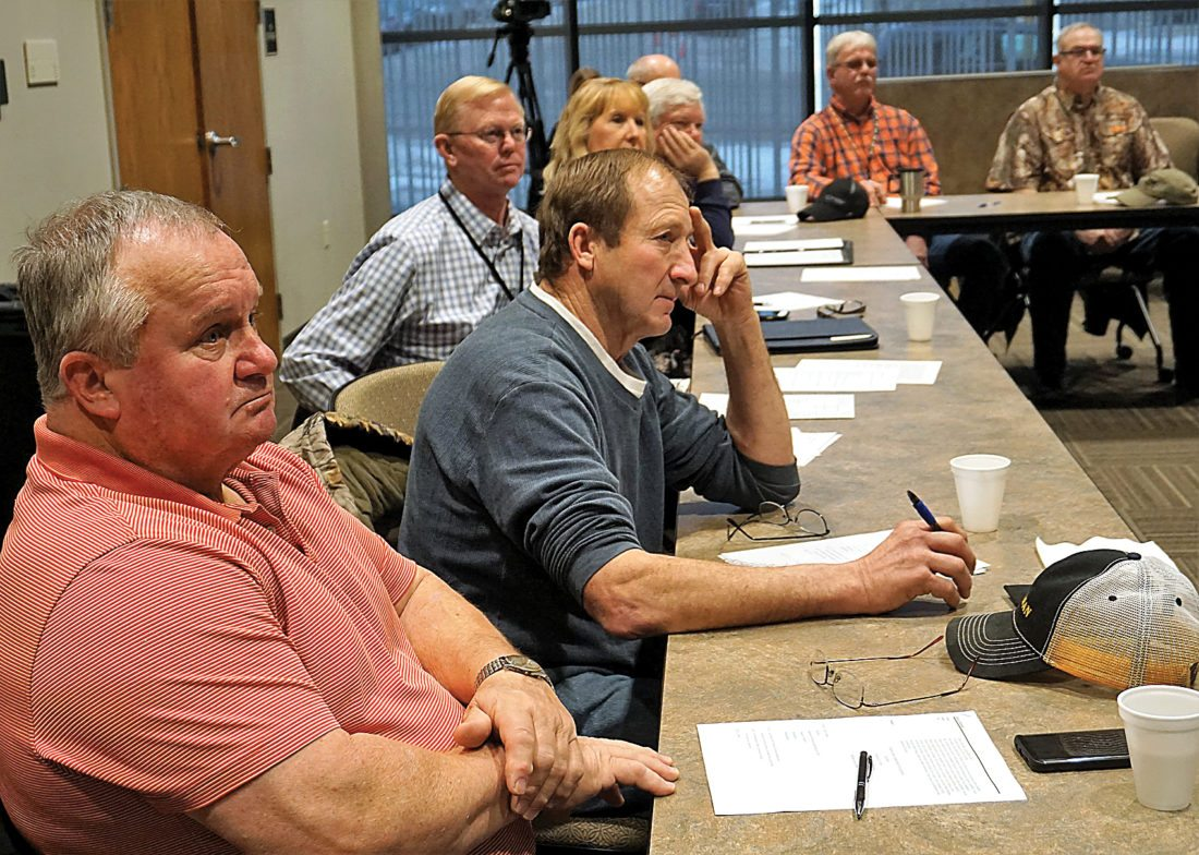 Jill Schramm/MDN Bryan Bruner, Drake, chairman of the Elmer Jesme Conference of Counties, and fellow McHenry County Commissioner Larry Haman, Towner, take in the discussion at Monday's meeting. Ward County Commissioners Jim Rostad and Shelly Weppler are seated behind them.