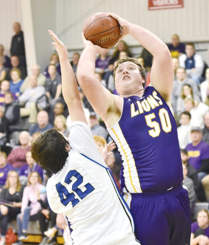Garrick Hodge/MDN Bishop Ryan's Jacob Lizotte (50) takes a fadeaway jumper while being guarded by Our Redeemer's Greyson Olthoff (42) Tuesday at a boys high school basketball game at ORCS.