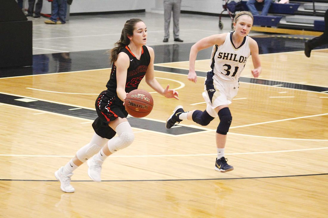 Ashton Gerard/MDN Rugby junior Anni Stier (25) is guarded by Shiloh Christian's Brittan Grubb (31) in a high school girls basketball game Dec. 28 at the Minot Municipal Auditorium.