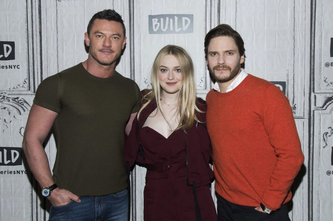 "Luke Evans, from left, Dakota Fanning and Daniel Brühl participate in the BUILD Speaker Series to discuss the ""The Alienist"" at AOL Studios on Thursday, Jan. 18, 2018, in New York. (Photo by Charles Sykes/Invision/AP)"