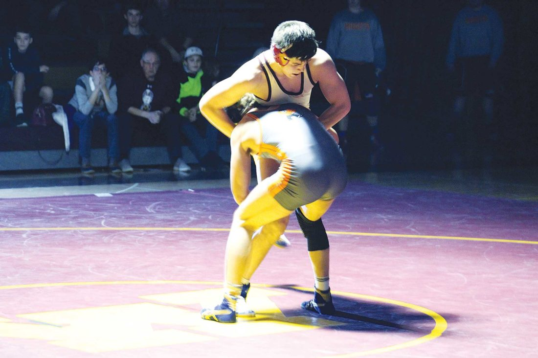 Ashton Gerard/MDN Minot High sophomore Jacob Carmichael fights for control over Dickinson's Tanner Jarrett in a wrestling match Thursday at the Minot High-Magic City Campus.