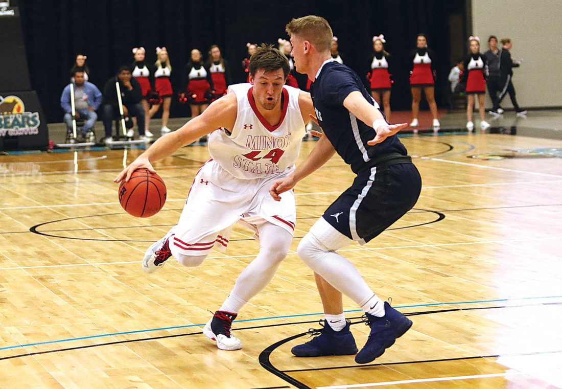 Sean Arbaut/Minot State Athletics Minot State's Tyler Rudolph (24) drives to the lane during a men's college basketball game earlier this season.
