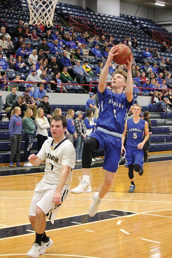 Alex Eisen/MDN  Stanley senior guard Matt Patten attempts a lay up in a Class B boys basketball game against Shiloh Christian on Saturday at the Minot Municipal Auditorium.
