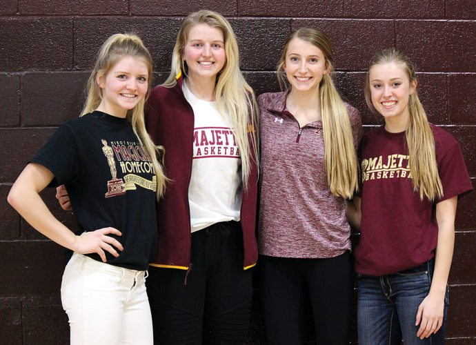 Alex Eisen/MDN Sisters Becca Tschetter and Brenna Tschetter, Allie Nelson and Brooke Nelson (left to right) make up an integral part of the Minot High School girls basketball team.