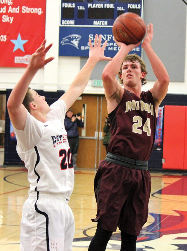 Minot High senior guard Peyton Lamoureux (24) takes a jump shot in a West Region boys basketball game played earlier this season against Century in Bismarck.   Alex Eisen/MDN
