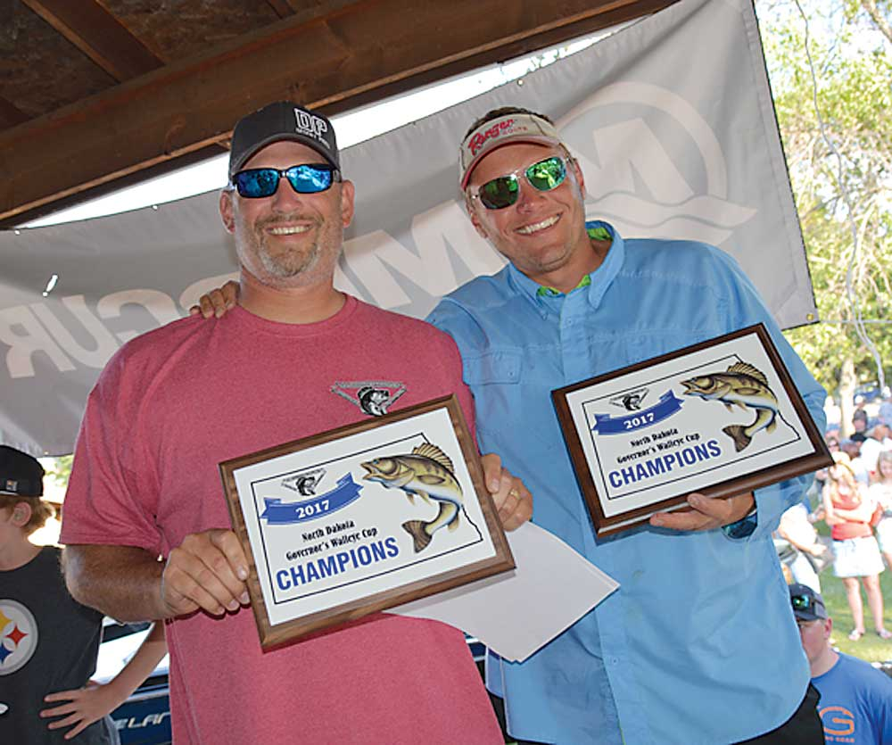 Submitted Photo Brad MacClennan, New Town, right, and Greg Mortenson, Burlington, will be team No. 1 in the 2018 Governor's Cup Walleye Derby headquartered in Garrison. This year's tournament field filled Jan. 17.