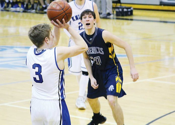 Ashton Gerard/MDN Our Redeemer's Noah Abel (3) pulls up for a shot as Mohall-Lansford-Sherwood's Beau Driscoll (20) calls for help Tuesday at Our Redeemer's. Coming from behind at the half, the Knights were able to come out on top with a final score of 63-51.