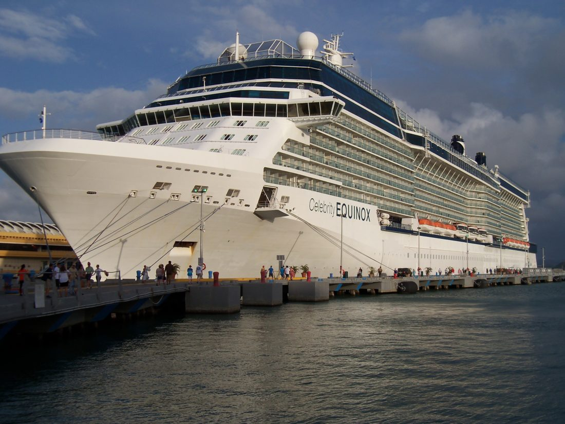 This June 13, 2017 photo shows Celebrity Cruises' Equinox at dock in San Juan, Puerto Rico. The ship carries 2,850 passengers, features a real grass lawn, Sky Observation Lounge and specialty restaurants like Tuscan Grille and Silk Harvest. (Joe Kafka via AP)