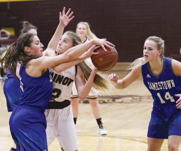 Photo courtesy of Sean Arbaut Minot High sophomore Allie Nelson (2) gets tangled up with a Jamestown defender in a West Region girls basketball game played Thursday at Minot High School.