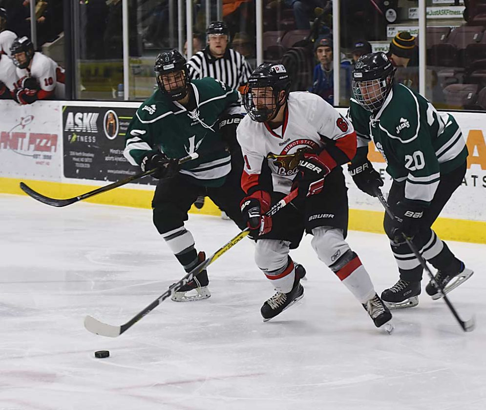 Garrick Hodge/MDN  Minot State's Shain Scheschuk (61) skates toward the net during a men's college hockey game Thursday at Maysa Arena.