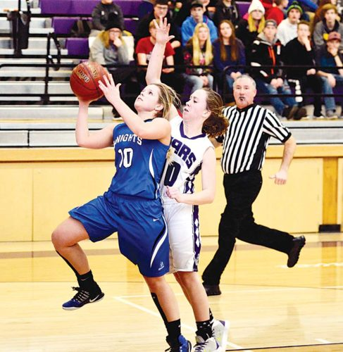 Matthew Semisch / Bottineau Courant Our Redeemer's forward Karlee Zablotney (10) skies forward for a layup while Bottineau's Sydnie Nelson defends during ORCS' 65-55 win over the Stars on Thursday in Bottineau.