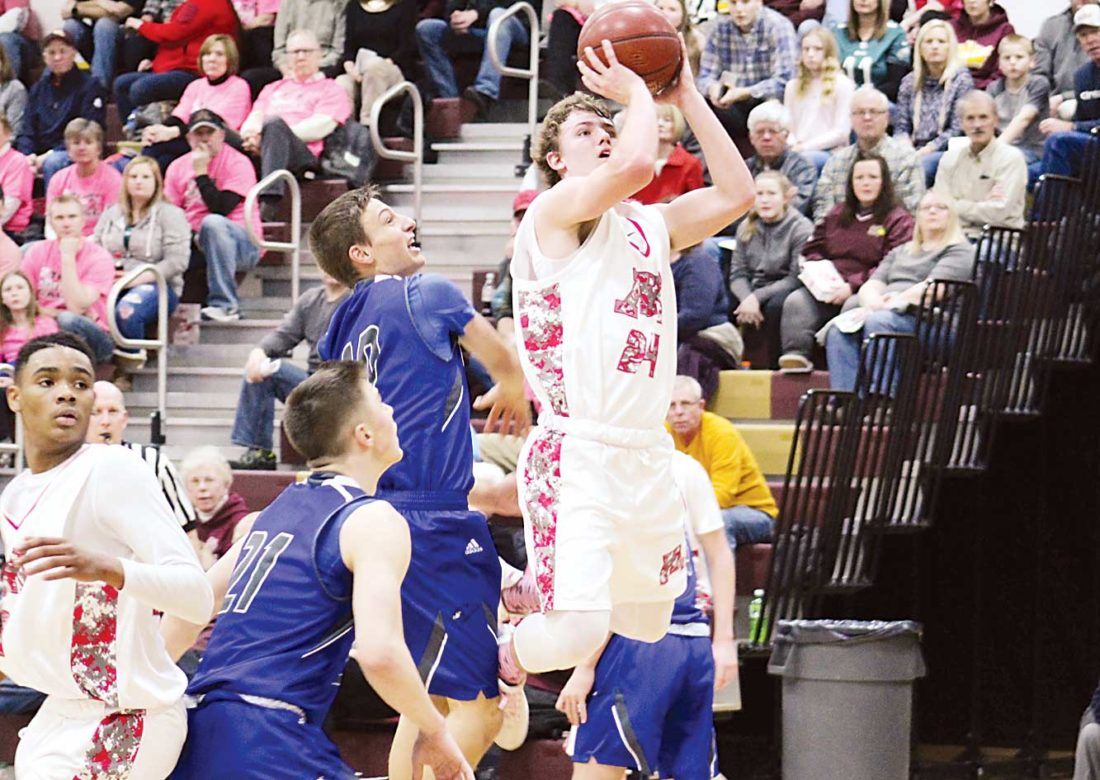 Ashton Gerard Minot High senior Peyton Lamoureux (24) goes for a layup Friday at Magic City Campus.