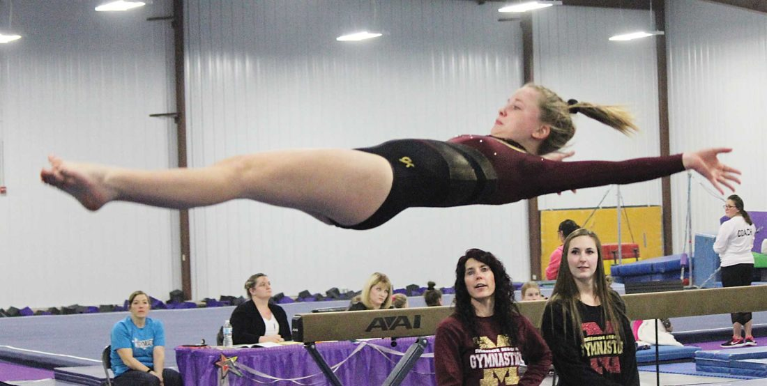 Alex Eisen/MDN Minot High seventh grader Makenna Peterson goes horizontal in a vault Friday evening in the Kim Lupo Memorial meet at the Gymagic Gymnastics Center.