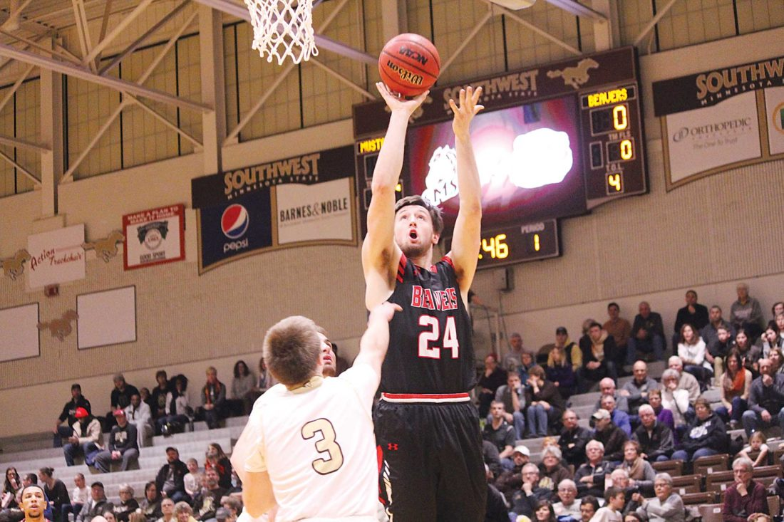 Sam Thiel/Marshall Independent  Minot State's Tyler Rudolph (24) puts up a shot during a men's college basketball game Friday in Marshall, Minn.