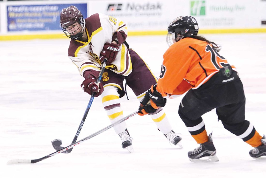 Photo courtesy of Sean Arbaut Majettes sophomore defender Brenna Abrahamson (10) takes a shot Saturday afternoon in a girls hockey game against Dickinson at Maysa Arena.