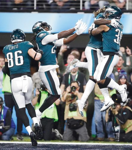 AP Photo Philadelphia Eagles teammates celebrate after beating New England 41-33 in Super Bowl 52 Sunday in Minneapolis.
