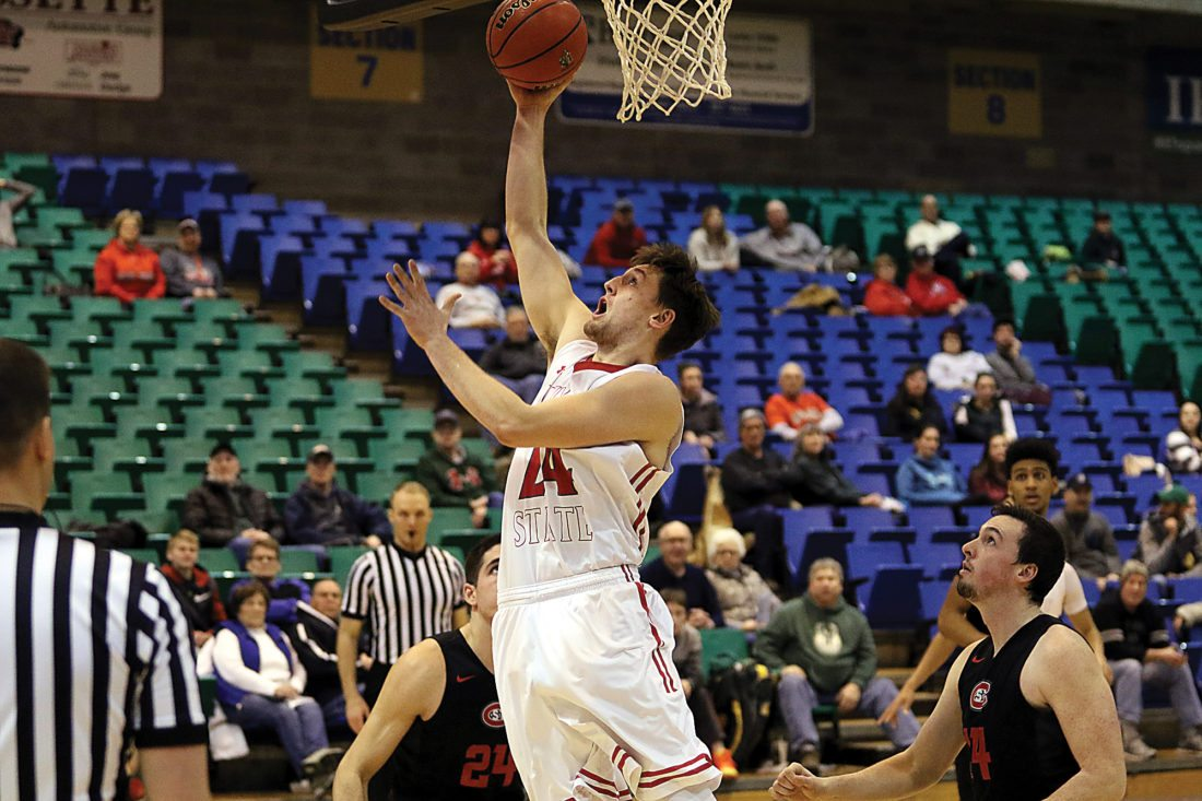Sean Arbaut/Minot State athletics  MSU's Tyler Rudolph (24) scores during a college basketball game earlier this season.