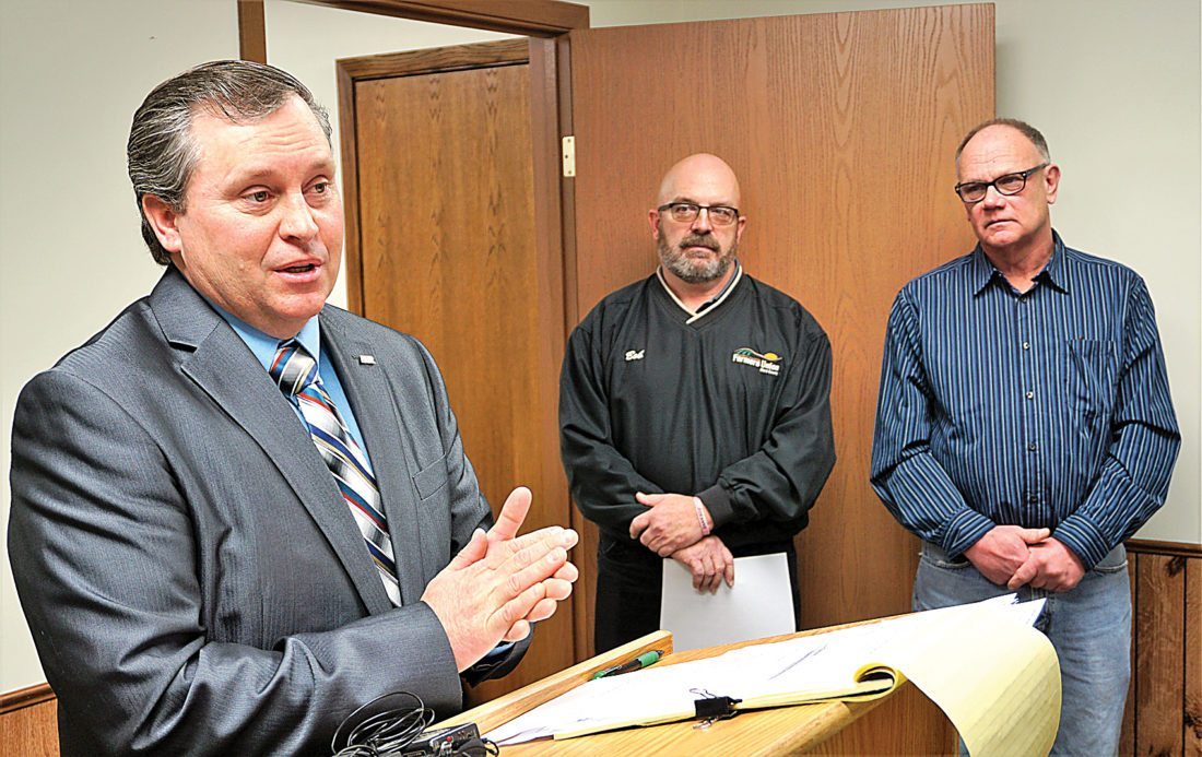 Jill Schramm/MDN Daryl Lies, N.D. Farm Bureau president, speaks at a Minot news conference as Bob Finken with Ward County Farmers Union, center, and John Pietsch with Ward County Farm Bureau, right, listen.