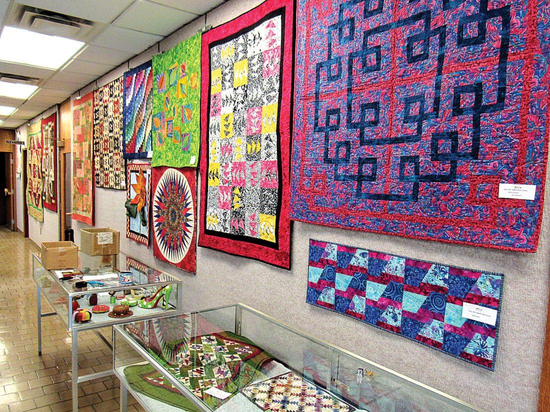 Submitted Photo The quilts made by the The Minot Prairie Quilt Guild will be displayed throughout the library hung up for people to enjoy.