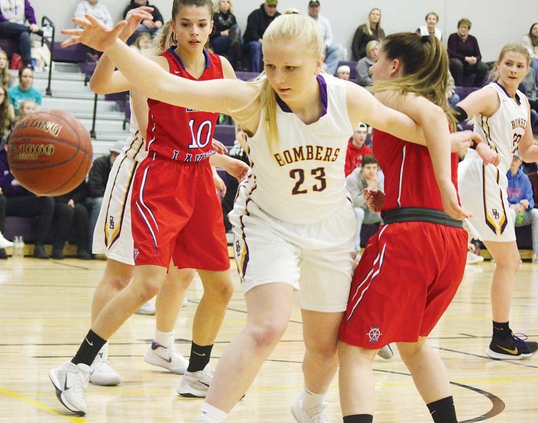 Alex Eisen/MDN Lewis & Clark-Berthold junior Abby Simons (23) reaches for a loose ball in a District 12 girls basketball game against Des Lacs-Burlington on Jan. 8 in Berthold.