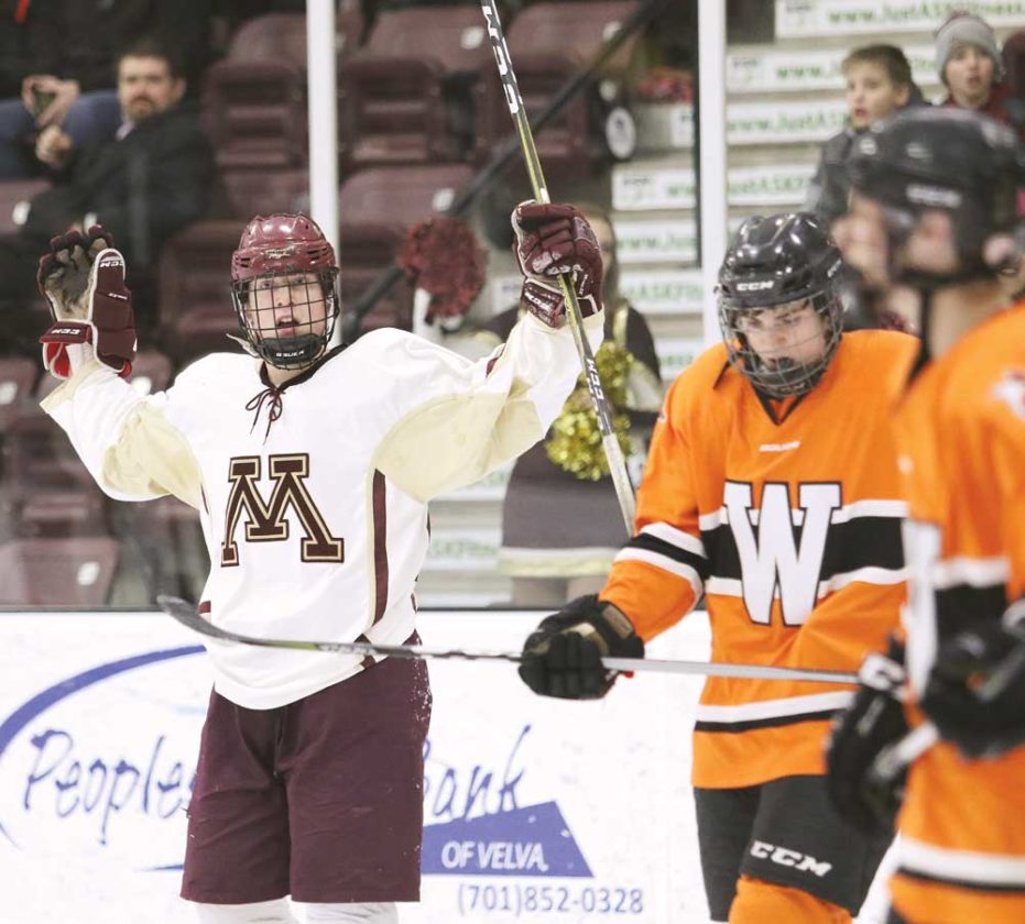 Photo courtesy of Sean Arbaut Minot High senior Brett Davis celebrates after scoring Minot's sixth goal Tuesday evening against Williston at Maysa Arena.