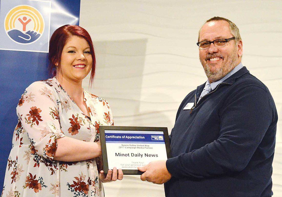 Eloise Ogden/MDN Tanya Washburn, left, advertising account executive at the Minot Daily News, accepts an award for the newspaper as a 2017 campaign media partner and its support of Souris Valley United Way. Numerous awards were presented to businesses and individuals at the annual SVUW Donor Recognition Awards Luncheon on Wednesday.