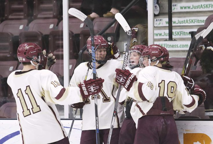 Photo courtesy of Sean Arbaut The Minot High boys hockey team celebrates after scoring a goal in the second period Thursday evening at Maysa Arena.