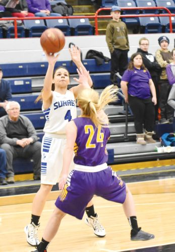 Garrick Hodge/MDN  Surrey guard Schyler Lemere (4) shoots a mid-range shot while Lewis & Clark Berthold's Hannah Ibach (24) defends during a girls District 12 basketball game Thursday at the Minot Auditorium.