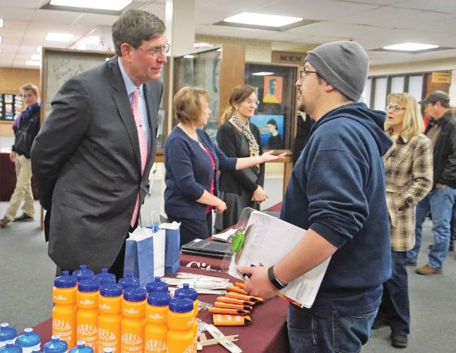 Jill Schramm/MDN Airport director Rick Feltner, left, visits with Edward Montez Thursday at the open house preceding the mayor's State of the City address at Magic City Campus.