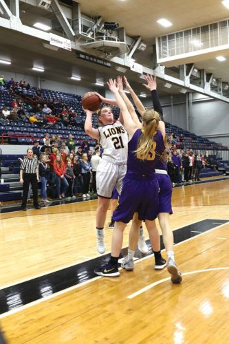 Photo courtesy of Al Christianson  Bishop Ryan's McKinlee Harmon (21) puts up a shot during a District 12 semifinal matchup Friday at the Minot Auditorium.