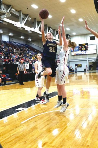 Photo courtesy of Al Christianson  Mohall-Lansford-Sherwood's Leah Feland (21) puts up a floater during the District 12 semifinals Friday at the Minot Auditorium.