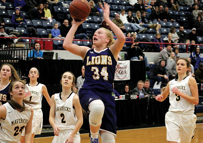 Garrick Hodge/MDN  Bishop Ryan's Emma Passa (34) lifts a floater while Mohall-Lansford-Sherwood's Janie Savelkoul (24) and Madison Moberg (2) can only watch during the District 12 championship Saturday at the Minot Auditorium.