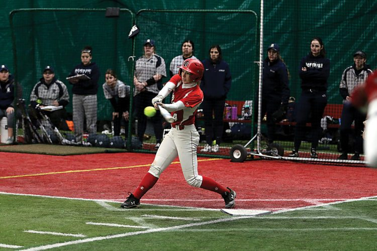 Sean Arbaut/Minot State athletics Minot State's Skyla Neubauer (4) connects with a pitch during a women's college softball game Sunday in Minot.
