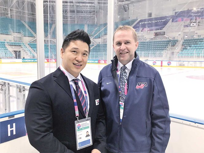 Submitted Photo Hockey coach David Hoff of Bottineau joins a South Korean coach as they stand next to the Olympic ice in PyeongChang, South Korea, during the World Champion para sled hockey games last April.