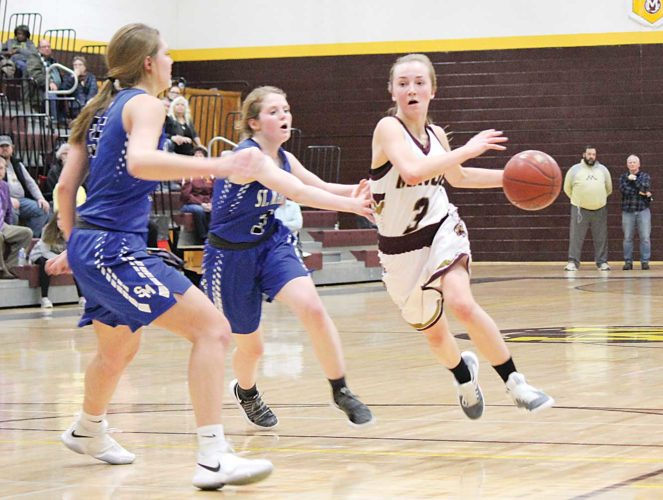 Alex Eisen/MDN Minot High sophomore Paige Rosencrans (3) drives the lane in a West Region girls basketball game Tuesday evening against Bismarck St. Mary's. Rosencrans made two free throws in the final second to force overtime.