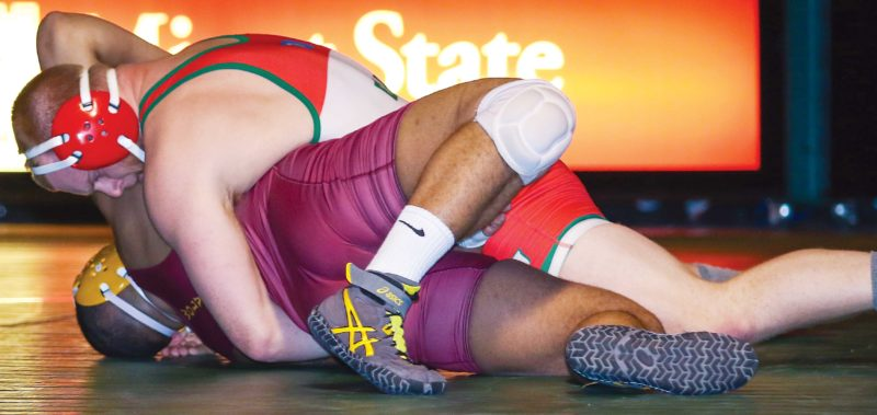 Sean Arbaut/Minot State athletics  Minot State's Mitchell Eull, top, pins Northern State's Justice Horn, bottom, en route to become the schools all-time career wrestling wins leader with 86.