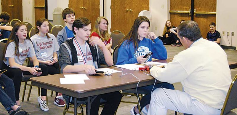 Andrea Johnson/MDN Evan Putt, an eighth-grader at Erik Ramstad Middle School, and Marissa Campbell, an eighth-grader at Memorial Middle School, face off during the countdown round of the Ward County Mathcounts competition on Wednesday at Minot State University. Marissa was the winner.